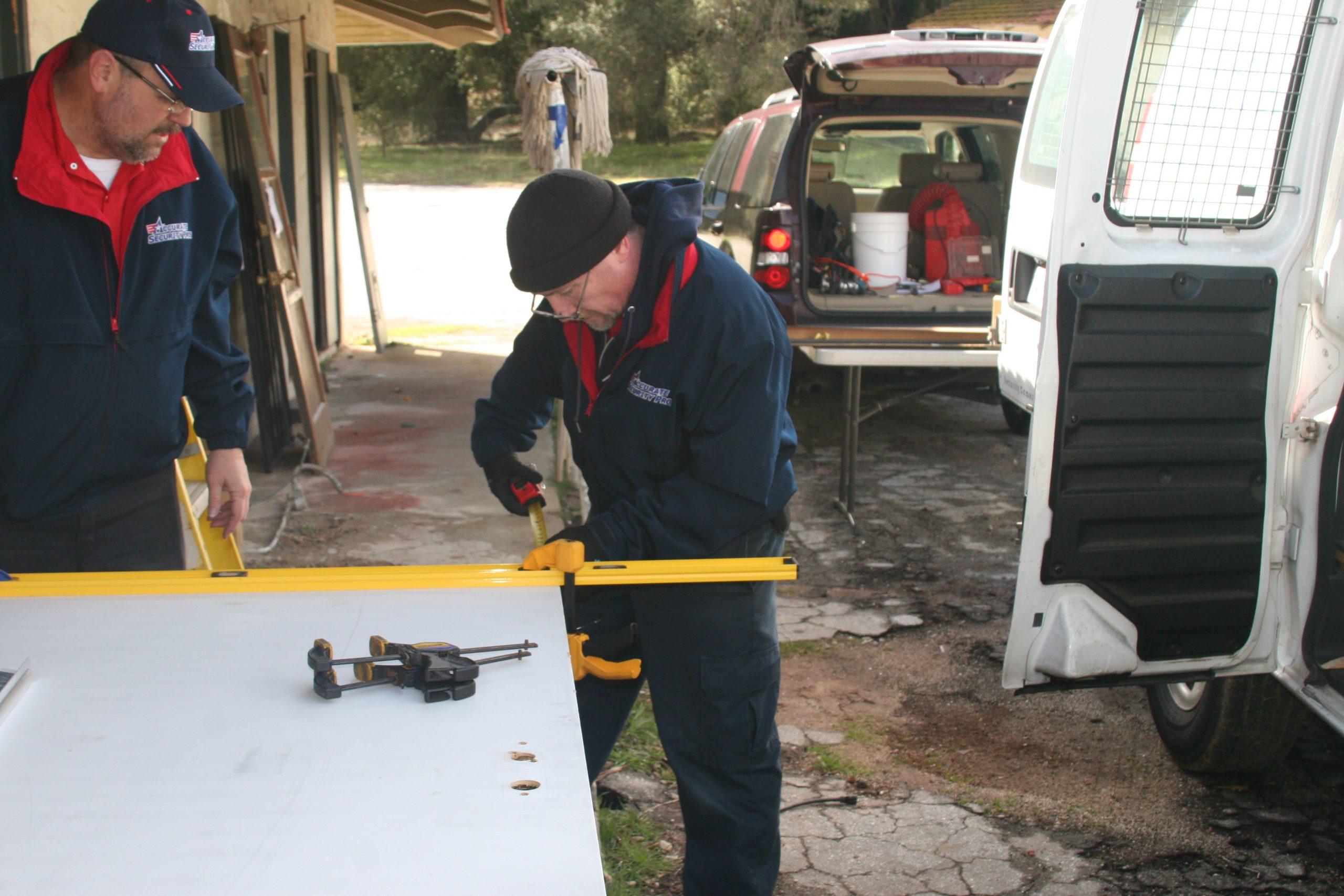 David Taking measurement to square up the door